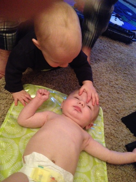 Phinehas discovering his newest cousin, Landon.